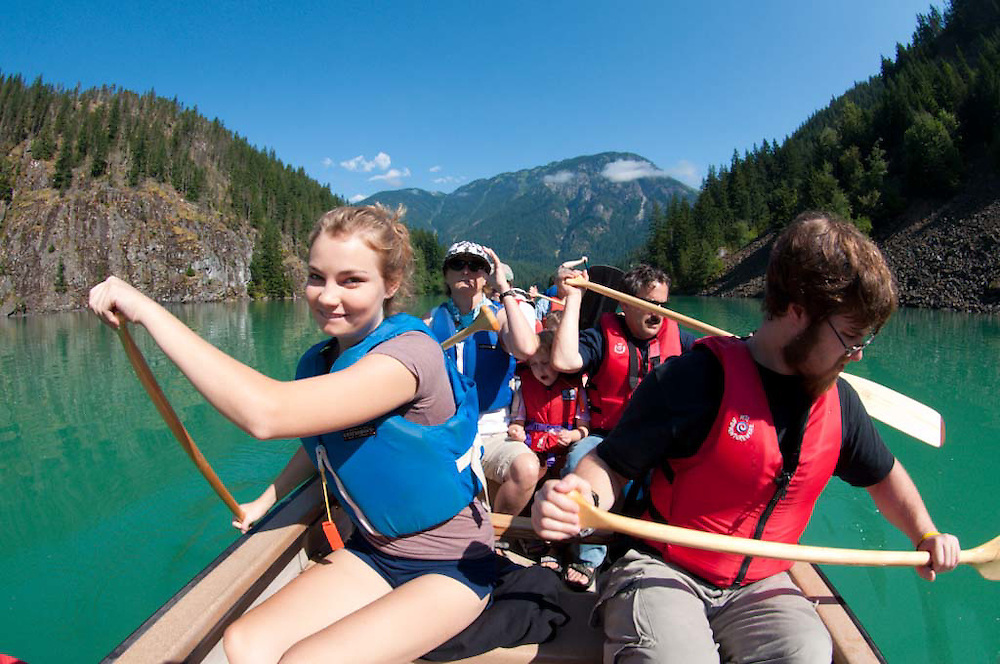 Paddling in North Cascades Institute's Twelve Person Canoe on Diablo Lake,  North Cascades National Park, Washington, US