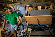HUSTLE, VIRGINIA - JULY 26: Randy Silvers inside his workshop, where he restores antique carriages, on his Rock Spring Farm on Sunday, July 26, 2015 in Hustle, Virginia. Silvers and his wife, Carolyn Berry, are giving away their 18th-century horse farm, that Silvers and his first wife rebuilt and restored, by hand-picking the next owner to the winner of an essay contest. (Photo by Pete Marovich For The Washington Post)