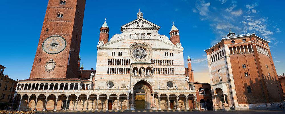 Romanesque facade & Baptistry of the Romanesque Cathedral of Cremona, begun 1107, with later Gothic, Renaissance & Baroque elements, Cremona, Lombardy, northern Italy .<br /> <br /> Visit our ITALY HISTORIC PLACES PHOTO COLLECTION for more   photos of Italy to download or buy as prints https://funkystock.photoshelter.com/gallery-collection/2b-Pictures-Images-of-Italy-Photos-of-Italian-Historic-Landmark-Sites/C0000qxA2zGFjd_k<br /> <br /> <br /> Visit our MEDIEVAL ART PHOTO COLLECTIONS for more   photos  to download or buy as prints https://funkystock.photoshelter.com/gallery-collection/Medieval-Middle-Ages-Art-Artefacts-Antiquities-Pictures-Images-of/C0000YpKXiAHnG2k