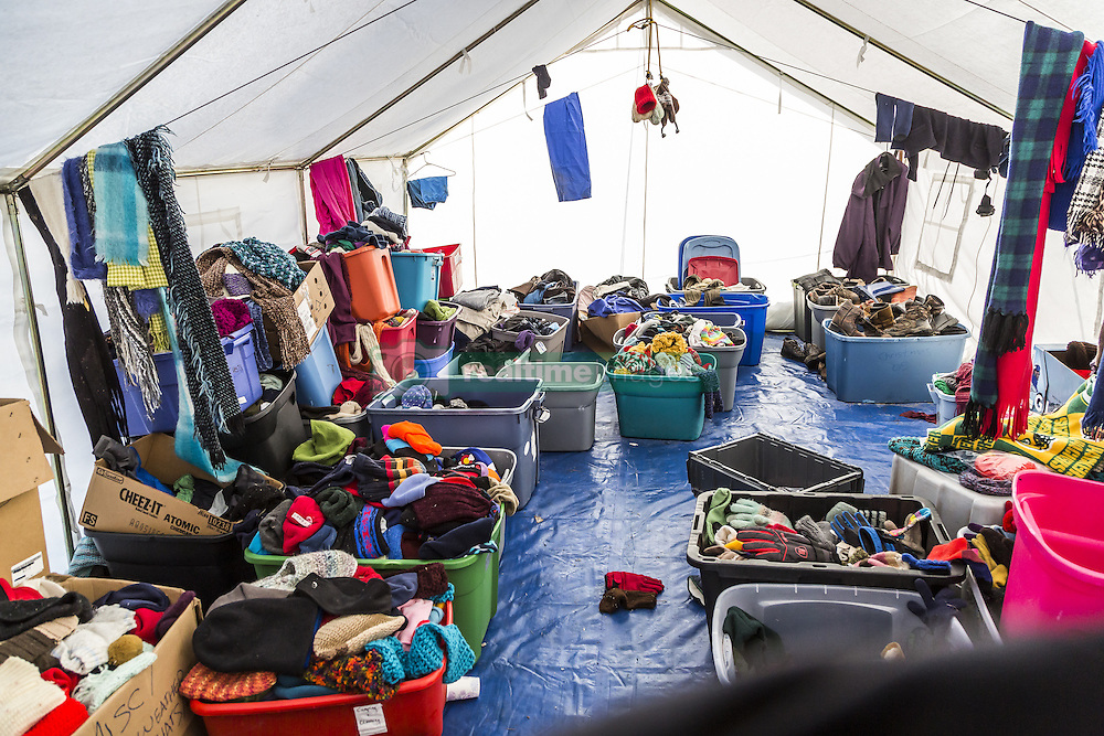 December 3, 2016 - Cannonball, North Dakota, United States - Tons of clothing has been donated to Standing Rock. This is one tent with hats and cloves. Veterans arrived en mass to Standing Rock, bringing a massive amount of supplies including winter clothing, food and firewood by the truck load.  Over 5000 veterans are anticipated to arrive by Sunday evening, prior to various actions slated to place. (Credit Image: © Michael Nigro/Pacific Press via ZUMA Wire)
