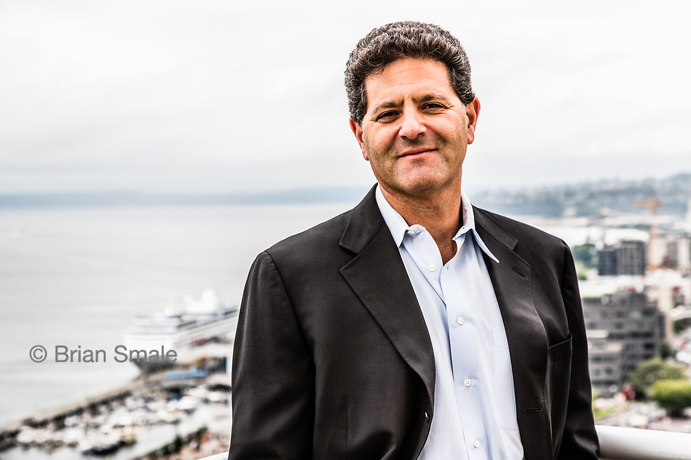 Nick Hanauer, Partner, Second Avenue Partners. Photographed on the roof garden near his office in downtown Seattle by Brian Smale for Der Spiegel Magazine. In the background is the Seattle waterfront, and Elliott Bay.
