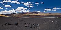 PAMPA NEGRA, SUELO NEGRO DE PIEDRAS VOLCANICAS Y VOLCAN PAYUN MATRU (3.680 m.s.n.m.) AL FONDO, RESERVA PROVINCIAL LA PAYUNIA (PAYUN, PAYEN), MALARGUE, PROVINCIA DE MENDOZA, ARGENTINA (PHOTO © MARCO GUOLI - ALL RIGHTS RESERVED)