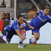 John Terry, (left) and Branislav Ivanovic, Chelsea, collide   during the Chelsea V AC Milan Guinness International Champions Cup tie at MetLife Stadium, East Rutherford, New Jersey, USA.  4th August 2013. Photo Tim Clayton