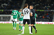\Match referee Stephen Martin speaks to Derby County forward Chris Martin (19) during the EFL Sky Bet Championship match between Derby County and Sheffield Wednesday at the Pride Park, Derby, England on 11 December 2019.