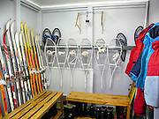 """Snowshoes, skiis, and boots equip Vernadsky Research Base (Akademik Vernadsky), a Ukrainian Antarctic Station at Marina Point on Galindez Island in the Argentine Islands, Antarctica. The United Kingdom first established research here as Base F or """"Argentine Islands"""" on Winter Island in 1947, then built a larger hut on Galindez Island in 1954, renamed it Faraday Station in 1977, and shocked the scientific community by discovering the Antarctic """"ozone hole"""" in 1985. The base was transferred to Ukraine in 1996."""