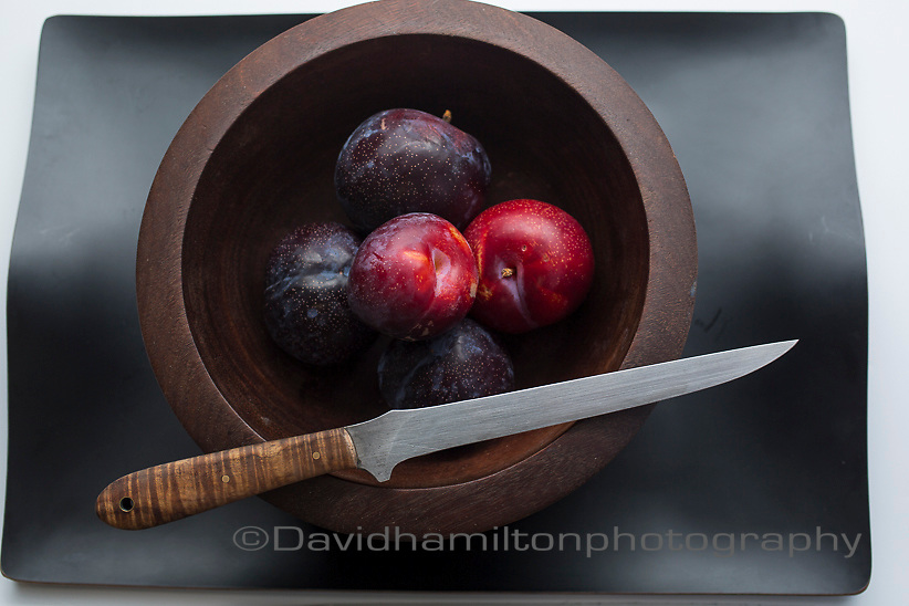 Plums in fruit bowl