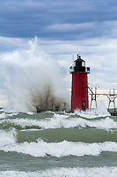 Winds sent waves crashing into the South Haven's pier and lighthouse under a clouded sky.