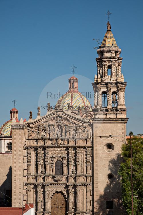 The Baroque Churrigueresque style Iglesia del Carmen church and convent in the historic center on the Plaza del Carmen in the state capital of San Luis Potosi, Mexico.