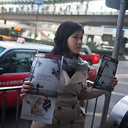 A Jehovah witness member hands out the Jehovah magazine 'Awake' to rush hour commuters in Central district.