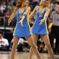 Mar 17, 2011; Tampa, FL, USA; UCLA Bruins cheerleaders performs during the second half of the second round of the 2011 NCAA men's basketball tournament game against the Michigan State Spartans at the St. Pete Times Forum. UCLA defeated Michigan State 78-76.  Mandatory Credit: Derick E. Hingle
