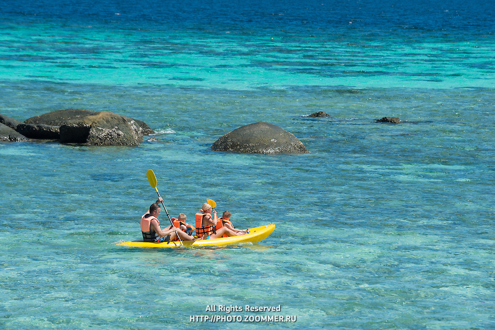 Family with two kids on Kayak in Andaman sea, Ko Lipe, Thailand