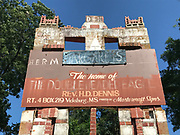 Archway entrance to grocery over 20 ft tall-**** sign on top Home of Double Headed Eagle and Herman Dennis (missing blue Margaret's sign- its in the collection ) <br />