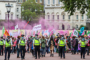 Police officers form a line outside ahead of protestors walking by St James' Park during an Extinction Rebellion protest in central London on Wednesday, Sept 3, 2020. The environmental nonviolent campaign group Extinction Rebellion plans to hold 10 days of demonstrations across central London as part of its ongoing campaign to highlight climate change. Peaceful actions swarmed central London into a standoff, demanding that the central government obeys and delivers Climate and Ecological Emergency Bill and prepare for crisis with a National Citizens' Assembly. (VXP Photo/ Vudi Xhymshiti)