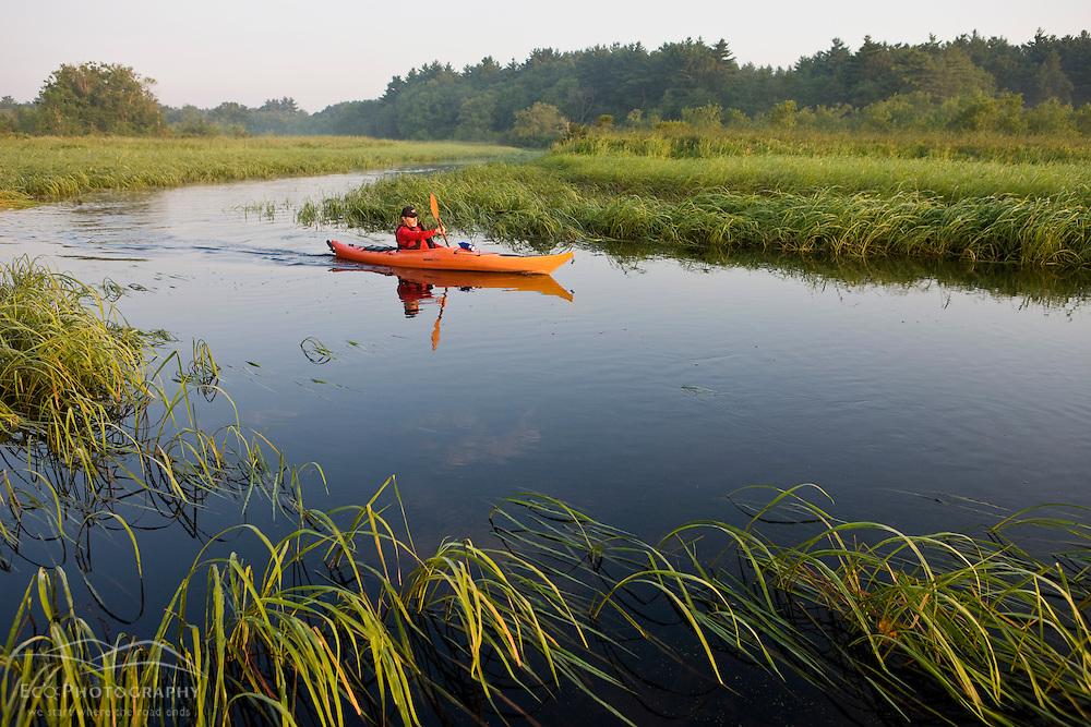 A man kayaks the Indian Head River in Hanover, Massachusetts.