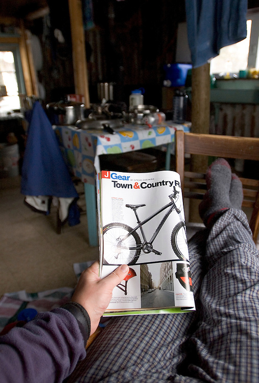 Reading a magazine at Camp Manitou cabin on the tip of the Keweenaw Peninsula near Copper Harbor, Michigan.