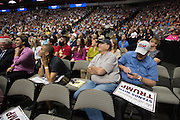 Visitors look on as republican presidential candidate Donald Trump speaks during a rally at the American Airlines Center in Dallas, Texas on September 14, 2015. (Cooper Neill for The New York Times)