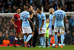 Manchester City's Gabriel Jesus (33) speaks with match referee Antonio Miguel Mateu Lahoz (third left) during the UEFA Champions League, Quarter Final at the Etihad Stadium, Manchester.