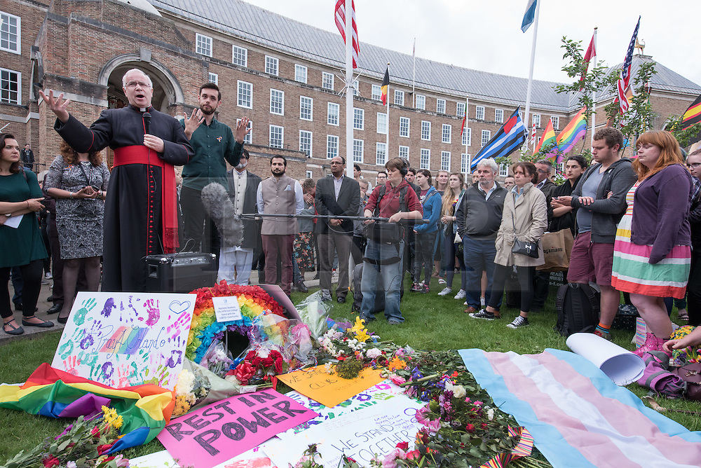 © Licensed to London News Pictures.14/06/2016. Bristol, UK.  David Hoyle, Dean of Bristol Cathedral, speaks at the Bristol Rainbow vigil for those killed and injured in the Orlando shooting in Florida, USA. About 1000 people gather on Bristol's College Green, including organisations Stand Against Racism & Inequality (SARI); Bristol Hate Crime Services; Bristol and other South West based Prides; Out Bristol; LGBT Bristol; Diversity Trust; Police LGBT Liaison; Bristol City Council. Afterwards people lit candles in Bristol Cathedral. Photo credit : Simon Chapman/LNP