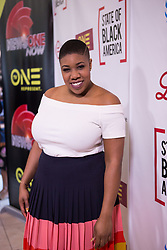 """May 2, 2017 - Washington, DC, United States - Symone Sanders, CNN Political Commentator, and former National Press Secretary for Sen. Bernie Sanders, on the red carpet for """"The State of Black America"""" town hall taping, at the Howard Theatre on May 3, 2017 in Washington, DC. (Credit Image: © Cheriss May/NurPhoto via ZUMA Press)"""