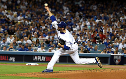 October 24, 2017 - Los Angeles, California, U.S. - Los Angeles Dodgers relief pitcher Brandon Morrow throws to the plate against the Houston Astros in the seventh inning of game one of a World Series baseball game at Dodger Stadium on Tuesday, Oct. 24, 2017 in Los Angeles. Dodgers won 3-1. (Photo by Keith Birmingham, Pasadena Star-News/SCNG) (Credit Image: © San Gabriel Valley Tribune via ZUMA Wire)