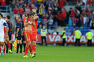 Gareth Bale of Wales looks on dejected at the final whistle as Wales can only draw and will have to wait a bit longer to achieve qualification.  Euro 2016 qualifying match, Wales v Israel at the Cardiff city stadium in Cardiff, South Wales on Sunday 6th Sept 2015.  pic by Andrew Orchard, Andrew Orchard sports photography.