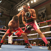 KISSIMMEE, FL - MARCH 06:  Edgardo Marin (R) trades punches with Alex Roman during the Telemundo Boxeo boxing match at the Kissimmee Civic Center on March 6, 2015 in Kissimmee, Florida. Marin won the bout on a split decision by the judges. (Photo by Alex Menendez/Getty Images) *** Local Caption *** Felix Verdejo; Sergio Villanueva