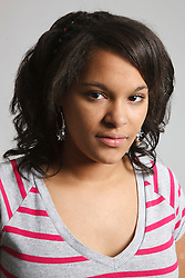 Studio portrait of mixed race teenage girl.