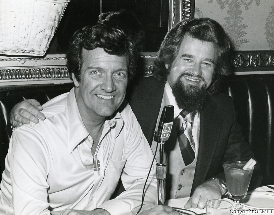 1978 Radio commentator and interviewer, Gregg Hunter, seen interviewing hypnotist/magician Peter Reveen during his KIEV radio show at the Brown Derby Restaurant on Vine St. in Hollywood