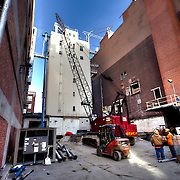 Mechanical tower at former Folgers Coffee plant being prepared for demolition.