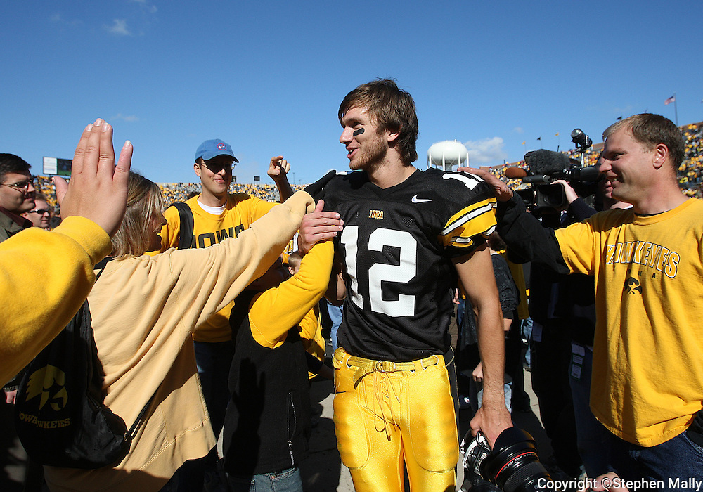 18 OCTOBER 2008: Iowa quarterback Ricky Stanzi (12) is congratulated by Iowa fans after an NCAA college football game against Wisconsin, at Kinnick Stadium in Iowa City, Iowa on Saturday Oct. 18, 2008. Iowa won 38-16.