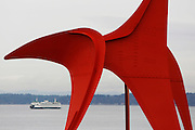 A state ferry, juxtaposed with The Eagle sculpture by Alexander Calder at Olympic Sculpture Park, crosses Elliott Bay to Seattle's waterfront. (Sy Bean / The Seattle Times)