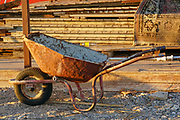 Rusty wheelbarrow in use