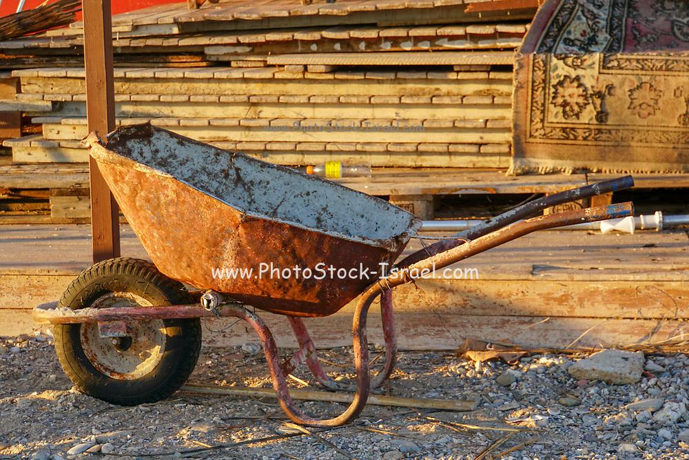 Rusty wheelbarrow in use
