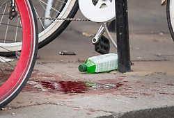 © Licensed to London News Pictures. 17/02/2019. London, UK. A large patch of blood on the pavement at the scene on Oxford Street in central London where three people were stabbed last night. The incident took place near Tape Nightclub. Photo credit: Ben Cawthra/LNP