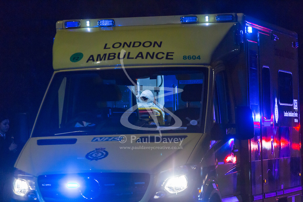 A man's bandage head is visible in an ambulance as Police and the London Ambulance Service respond to a serious assault on Harrow Road near Ladbroke Grove in North West London at around 3.30am. London, January 01 2019.
