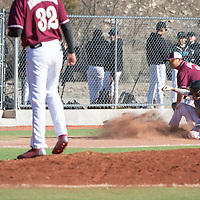 Navajo Pine Warriors junior Dempsey Lincoln (4) is safe on the play after the attempt to steal third base after the ball gets past Tohatchi Cougar third basemen Samuel Balone (35) at Ford Canyon Park in Gallup Friday.