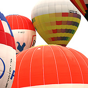 Lupercio Lima, Brazil, (right) takes to the skies around rural Michigan near Battle Creek as balloons launch during the World Hot Air Ballooning Championships. Battle Creek, Michigan, USA. 19th August 2012. Photo Tim Clayton