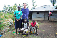 Bill Nighy with Dodien who looks after her mother Grace who is HIV+.  Grace also takes care of her brother John and sister Enon.
