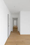 Empty white corridor with open doors. Front view. Nobody inside