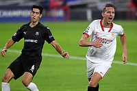 SEVILLE, SPAIN - OCTOBER 28: Luuk de Jong of FC Sevilla and Nayef Aguerd of Stade Rennais during the UEFA Champions League Group E stage match between FC Sevilla and Stade Rennais at Estadio Ramon Sanchez-Pizjuan on October 28, 2020 in Seville, Spain. (Photo by Juan Jose Ubeda/ MB Media).