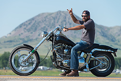 Cruising along Highway 34 with Bear Butte Mountain in the background during the 75th Annual Sturgis Black Hills Motorcycle Rally.  SD, USA.  August 2, 2015.  Photography ©2015 Michael Lichter.