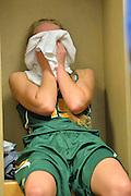 April 4, 2016; Indianapolis, Ind.; Alysha Devine sits in her locker after the Seawolves fell to Lubbock Christian 78-73 the NCAA Division II Women's Basketball National Championship game at Bankers Life Fieldhouse.