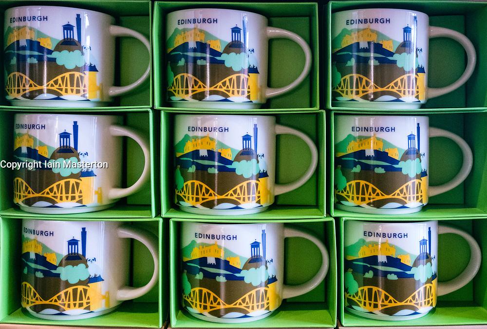 Starbucks mugs for sale in Edinburgh Cafe with themed city logos.
