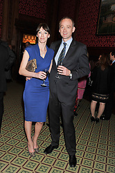 SIMON PHILIPS and his wife NICKI PHILIPS at a gala dinner in aid of Nyumbani the Hot Courses Foundation held in The Members Dining Room,  The House of Commons, London on  7th March 2013.