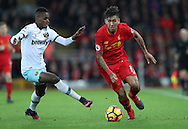 Edimilson Fernandes of West Ham United and Roberto Firmino of Liverpool during the Premier League match at Anfield Stadium, Liverpool. Picture date: December 11th, 2016.Photo credit should read: Lynne Cameron/Sportimage