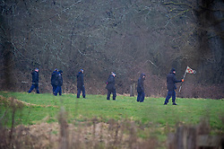 © Licensed to London News Pictures 10/03/2021. Ashford, UK. A police search team in the grounds. Teams of police officers are at Great Chart Leisure in Ashford, Kent which is believed to be part of an ongoing investigation into the disappearance of Sarah Everard from London. Photo credit:Grant Falvey/LNP