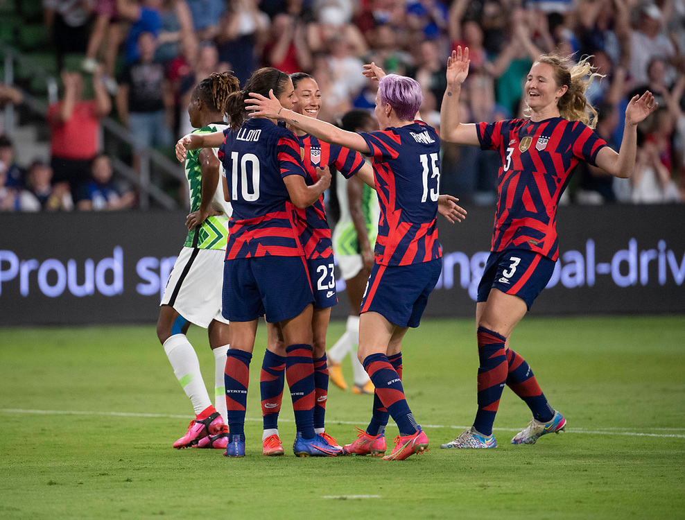 Players CARLI LLOYD (10), MEGAN RAPINOE (15) and SAMANTHA MEWIS (3) greet CHRISTEN PRESS (23) after her first goal as the US Women's National Team (USWNT) beats Nigeria, 2-0 in the inaugural match of Austin's new Q2 Stadium. The U.S. women's team, an Olympic favorite, is wrapping up a series of summer matches to prep for the Tokyo Games.
