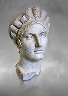 Roman marble portrait bust of Matidia circa119 AD from Via Giolitti, Rome. Matidia was Sabina's mother and Hadrian's wife. The high level of idealisation of the portrait suggests that it was made after her death. Capitoline Museums, Rome ..<br /> <br /> If you prefer to buy from our ALAMY STOCK LIBRARY page at https://www.alamy.com/portfolio/paul-williams-funkystock/greco-roman-sculptures.html . Type -    Capitoline    - into LOWER SEARCH WITHIN GALLERY box - Refine search by adding a subject, place, background colour, etc.<br /> <br /> Visit our ROMAN WORLD PHOTO COLLECTIONS for more photos to download or buy as wall art prints https://funkystock.photoshelter.com/gallery-collection/The-Romans-Art-Artefacts-Antiquities-Historic-Sites-Pictures-Images/C0000r2uLJJo9_s0