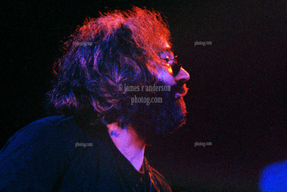 "Jerry Garcia with The Grateful Dead Live at Huntington West Virginia 16 April 1978. Jerry looking right over to Keith on piano with the knowing look of ""this is working"". Image No. 78C03-26"
