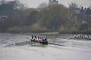 Greater London. United Kingdom, Right Cambridge women's Blue Boat heading Oxford.  as both crews move past Chiswick Eyot, University Boat Races , Cambridge University vs Oxford University. Putney to Mortlake,  Championship Course, River Thames, London. <br /> <br /> Saturday  24.03.18<br /> <br /> [Mandatory Credit  Intersport Images]